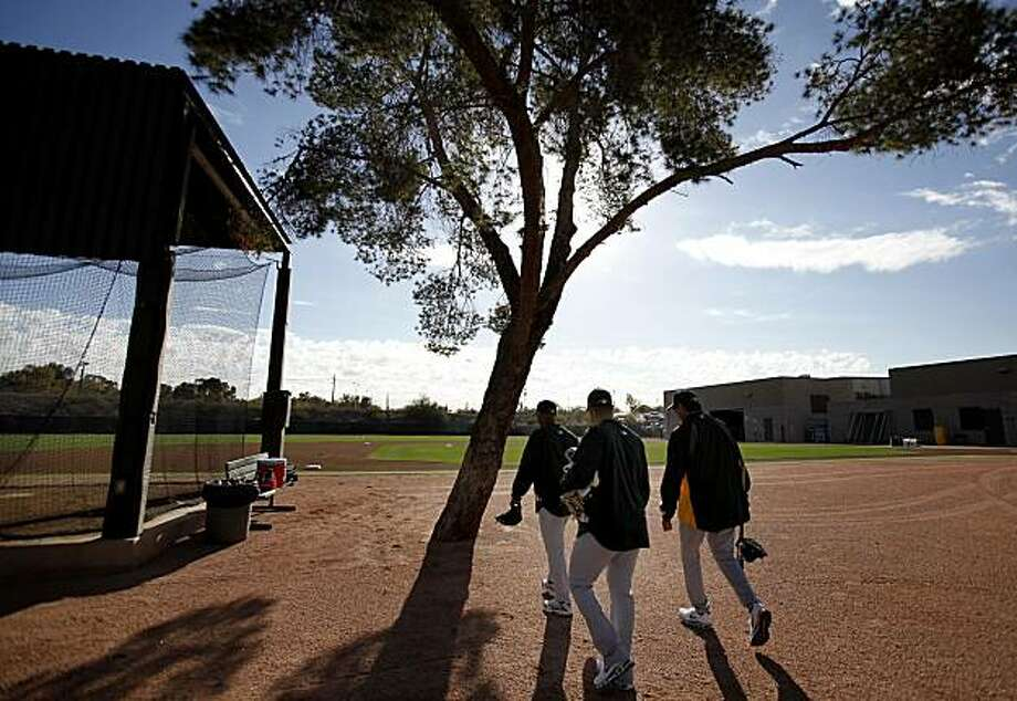 A group of A's pitchers walked to their early morning stretching. The Oakland Athletics held their second workout of the spring mostly for pitchers and catchers Thursday February 17, 2011 at Phoenix Stadium. Photo: Brant Ward, The Chronicle
