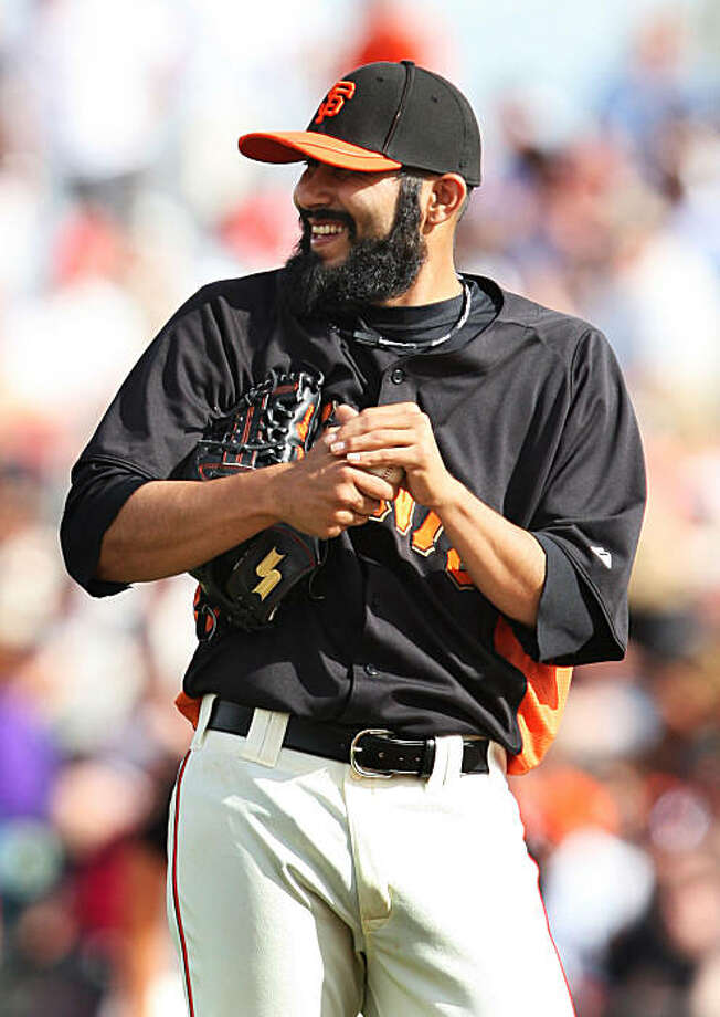 San Francisco Giants pitcher Sergio Romo jokes with teammates as he steps onto the mound to face the Seattle Mariners in the sixth inning of their spring training game at Scottsdale Stadium in Scottsdale, Ariz., on Sunday. Photo: Lance Iversen, The Chronicle