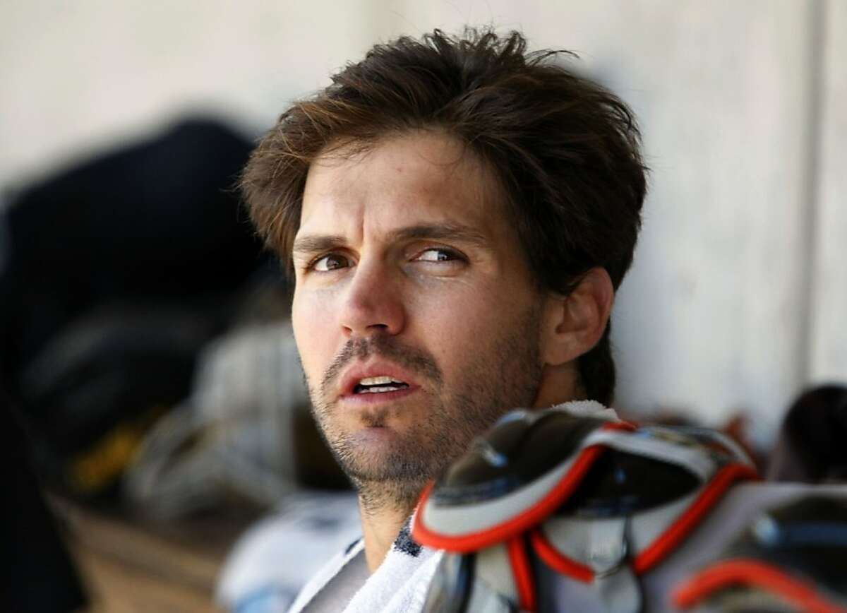 San Francisco Giants starting pitcher Barry Zito cools down in the dugout after reaching his pitch count and being relieved in a spring training game against the Milwaukee Brewers at Maryvale Park in Phoenix on Monday.