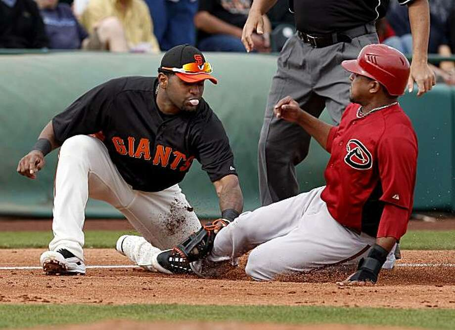 Pablo Sandoval tagged out Tony Abreu after Abreu tried to advance on a misplay. The San Francisco Giants defeated the Arizona Diamondbacks at the first exhibition game of the 2011 season at Scottsdale Stadium. Photo: Brant Ward, The Chronicle
