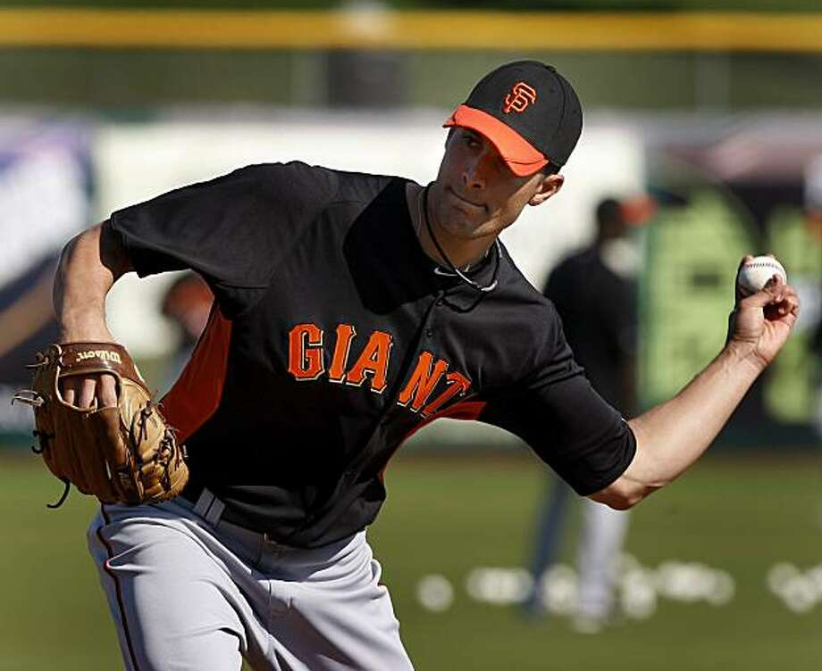 Giants pitcher Javier Lopez works on a bunting drill. The San Francisco Giants held a workout at their Scottsdale Stadium facility Wednesday February 24, 2011 and also a short inter squad game. Photo: Brant Ward, The Chronicle