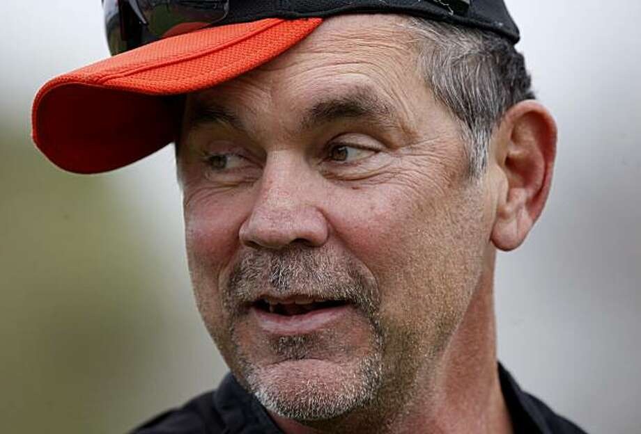 Giants manager Bruce Bochy had some fun with his hat while warming up. The San Francisco Giants worked out at Scottsdale Stadium Friday February 18, 2011. Photo: Brant Ward, The Chronicle
