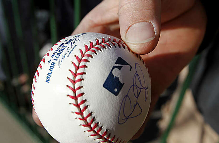 A fan held a ball signed by Buster Posey. The San Francisco Giants held their second workout of the spring training season at Scottsdale Stadium in Arizona Wednesday February 16, 2011. Photo: Brant Ward, The Chronicle
