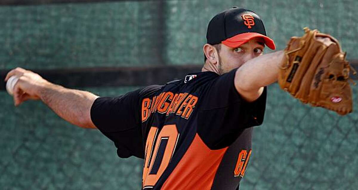 Madison Bumgarner threw to Buster Posey at practice. The San Francisco Giants held their second workout of the spring training season at Scottsdale Stadium in Arizona Wednesday February 16, 2011.