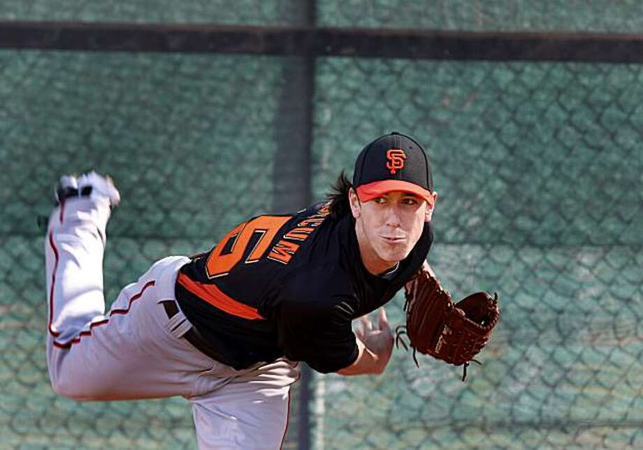 Tim Lincecum enjoyed watched his pitch during his first pitching workout of the spring. The 2010 World Champion San Francisco Giants held their first workout of the spring at Scottsdale Stadium Tuesday February 15, 2011. Photo: Brant Ward, The Chronicle