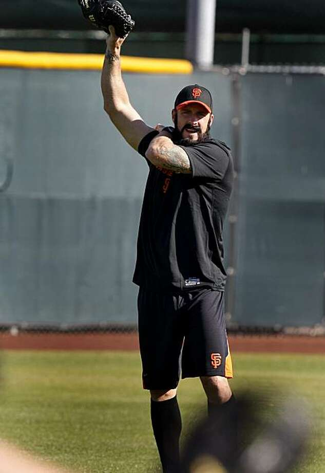 Brian Wilson massaged his arm during the first workout. The first day of spring training for the 2010 World Champion San Francisco Giants involved mostly pitchers and catchers in Scottsdale, Arizona Monday February 14, 2011. Photo: Brant Ward, The Chronicle