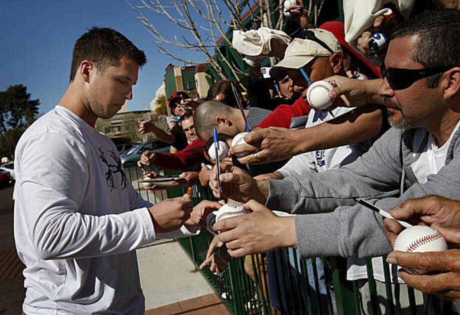 Buster Posey stopped to sign autographs for dozens of fans before going to the clubhouse at Scottsdale Stadium. The first day of spring training for the 2010 World Champion San Francisco Giants involved mostly pitchers and catchers in Scottsdale, Arizona Monday February 14, 2011. Photo: Brant Ward, The Chronicle