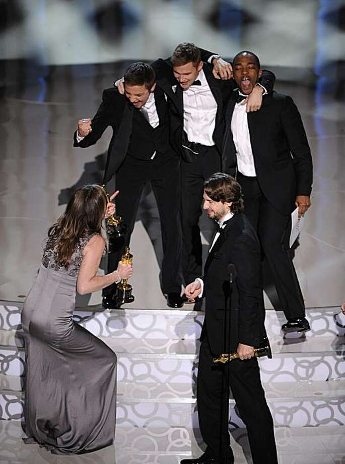 """In foreground, Kathryn Bigelow, left,  and Mark Boal,  celebrate with cast of """"The Hurt Locker"""" as they accept the Oscar for best motion picture of the year at the 82nd Academy Awards Sunday, March 7, 2010, in the Hollywood section of Los Angeles. In background from left are Jeremy Renner, Brian Geraghty  and Anthony Mackie. Photo: Mark J. Terrill, AP"""