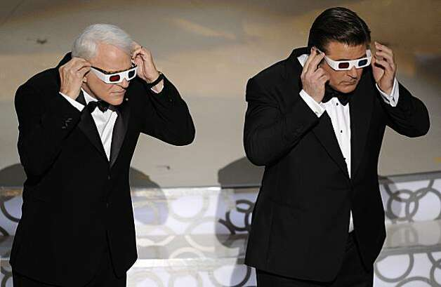 Host Alec Baldwin, right, and Steve Martin are seen on stage at the 82nd Academy Awards Sunday,  March 7, 2010, in the Hollywood section of Los Angeles. Photo: Mark J. Terrill, AP