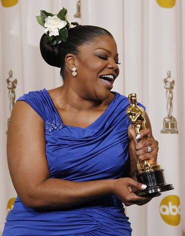 "Mo'Nique poses backstage with the Oscar for best performance by an actress in a supporting role for ""Precious: Based on the Novel 'Push' by Sapphire"" at the 82nd Academy Awards Sunday, March 7, 2010, in the Hollywood section of Los Angeles. (AP Photo/Matt Sayles) ** EMBARGOED AT THE REQUEST OF THE ACADEMY OF MOTION PICTURE ARTS & SCIENCES FOR USE UPON CONCLUSION OF THE ACADEMY AWARDS TELECAST **  Ran on: 03-08-2010 From left: hosts Steve Martin (left) and Alec Baldwin; best supporting actress Mo'Nique; and best actress Sandra Bullock. Ran on: 03-08-2010 Mo'Nique won best supporting actress for her role as a depraved mother from hell in &quo;Precious.&quo; Photo: Matt Sayles, AP"