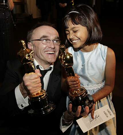 "Slumdog Millionaire director Danny Boyle, left, poses with Rubiana Ali, who portrayed young ""Latika,"" as they arrive at the Governors Ball following the 81st Academy Awards Sunday, Feb. 22, 2009, in the Hollywood sectio"