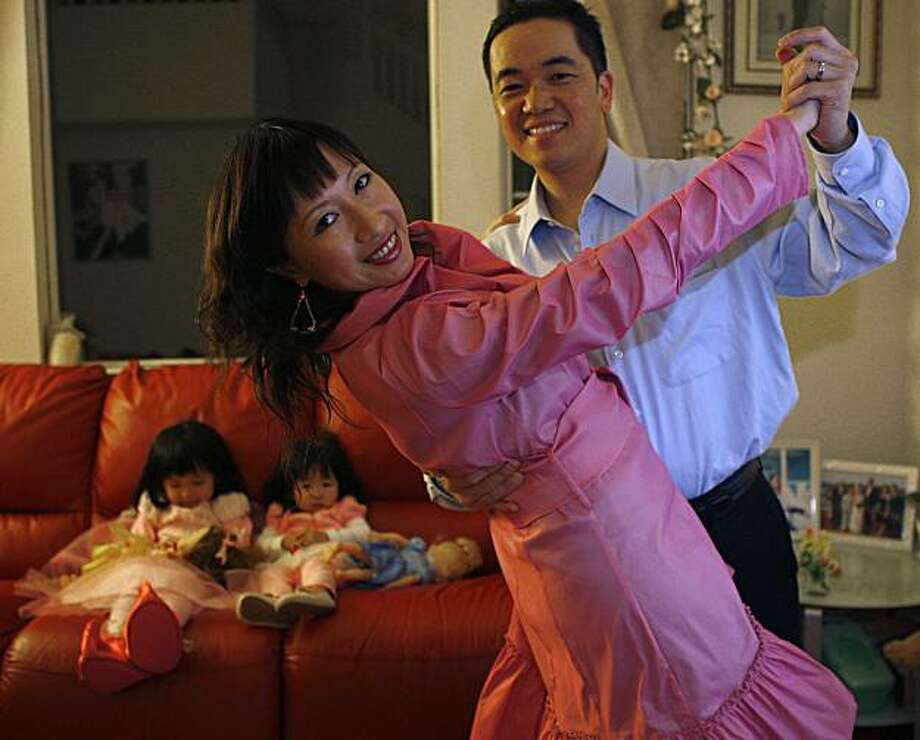 Mina Li and Anthony Ku, who both share an interest in ballroom dancing, at home with their two children in South San Francisco, Calif., on Wednesday, December 29, 2011. Photo: Liz Hafalia, The Chronicle