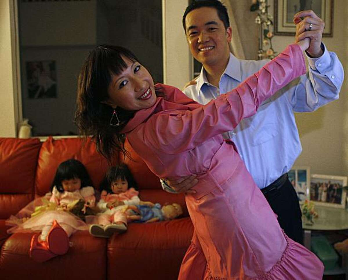 Mina Li and Anthony Ku, who both share an interest in ballroom dancing, at home with their two children in South San Francisco, Calif., on Wednesday, December 29, 2011.