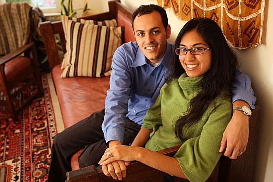 Yousef Turshani (left) and Nadeah Vali (right) sharing some time at home in San Francisco, Calif., on Friday, October 29, 2010.  Yousef, a Libyan American raised in the Kentucky and Florida, and Nadeah, a Pakistani Indian American from Southern California met two years ago at professional gathering in Los Angeles. Photo: Liz Hafalia, The Chronicle