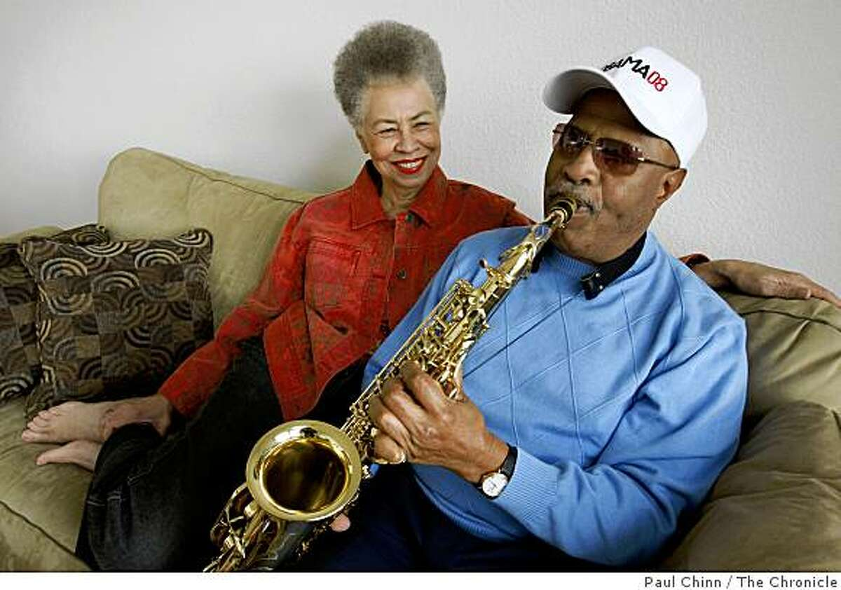 John Handy (right) plays the saxophone for his wife Del Anderson Handy on the couch in their home in Oakland, Calif., on Friday, Dec. 19, 2008.
