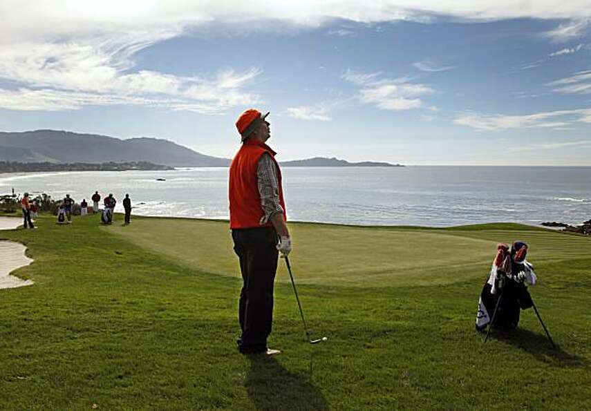Bill Murray prepares to chip onto the eighth green at the AT&T National Pebble Beach Pro-Am on Sunda