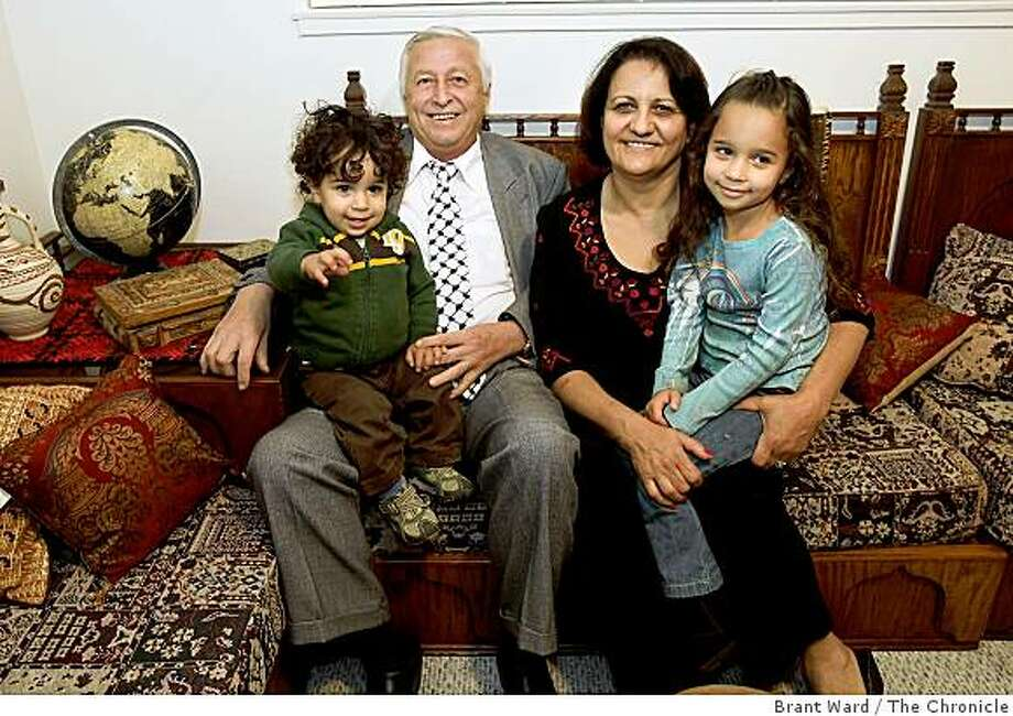 Nahida (right) and Adham Salem have just celebrated their 40th wedding anniversary. They sit with their two grandchildren: Qais Dudum (cq)(left) and Tala Dudum (right). Photo: Brant Ward, The Chronicle