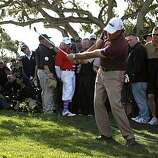 Phil Mickelson chips onto the 14th green in the final round of the AT&T Pebble Beach National Pro-Am on Sunday. Mickelson finished in a tie for ninth place, eight under par.