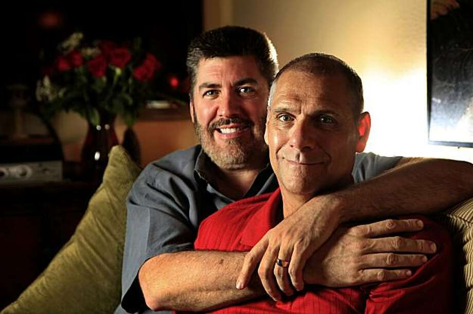 Steve Benoit and Larry Bushy (l to r) are seen on their couch in San Francisco, Calif. on Monday February 1, 2010. Benoit and Bushy met in 1989 and were married at City Hall in 2004 and 2008, on Valentine's Day. Photo: Lea Suzuki, The Chronicle
