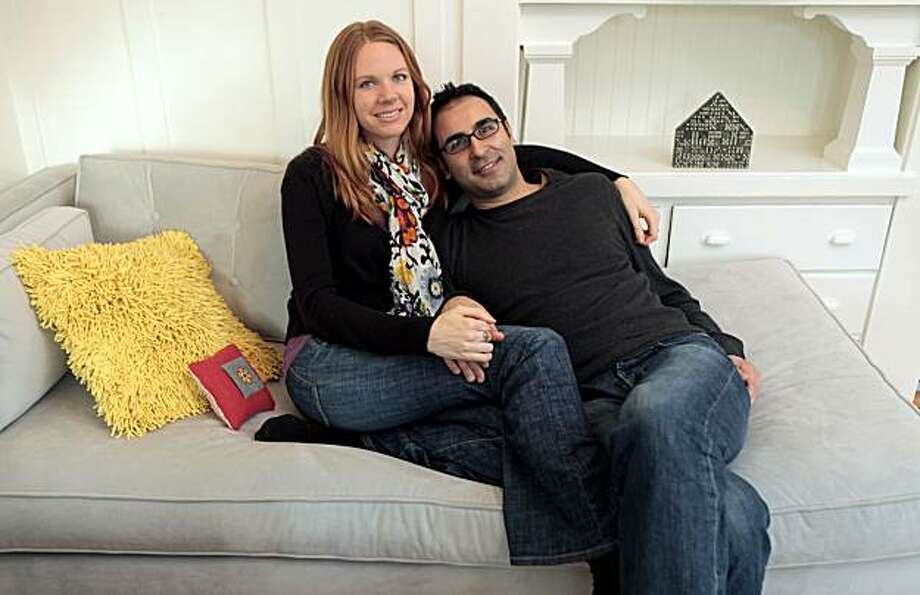 Carey Goron and Emre Gunduz are a long-distance couple that are in the process of moving to the Bay Area. While searching for a home of their own they are house-sitting for their friend Louise Rafkin in Oakland Saturday Feb. 6, 2010. Photo: Lance Iversen, The Chronicle