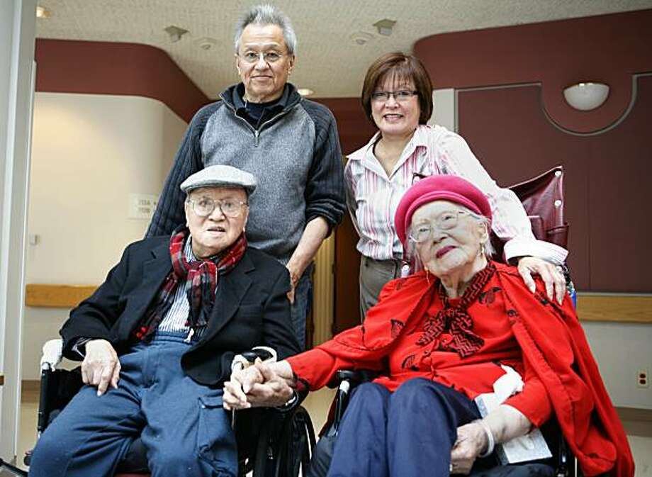 100 year-old William Chan (bottom left) and his 98-year old wife Cora Chan (bottom right)  pose with their children Curtiss (top left) and Lori Chan (top right) at the Jewish Home on Friday August 6, 2010 in San Francisco Calif. Photo: Jasna Hodzic, The Chronicle