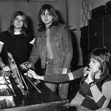 "18th November 1971: Progressive rock group ELP, or Emerson, Lake and Palmer, in the studio for the recording of their album, ""Trilogy."" From left to right: Carl Palmer (drums), Greg Lake (vocals, bass, guitar) and Keith Emerson (keyboards).."