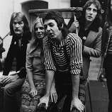 30th November 1972: Paul and Linda (1941 - 1998) McCartney with members of their pop group Wings.