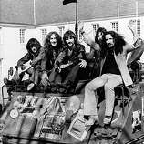 27th April 1972: British pop rock group Uriah Heep arrive sitting on the back of a tank at the Benrather Castle in Germany to promote their current tour of the country.