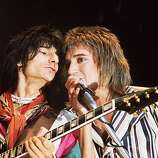 Circa 1975: Singer Rod Stewart and guitarist Ron Wood of The Faces in concert.