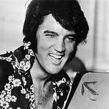 "Circa 1975: American popular singer and film star Elvis Presley (1935 - 1977), to his fans the undisputed ""King of Rock 'n' Roll."""