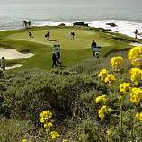 Spencer Levin (left) and Aaron Baddeley prepare to putt on the par-3 seventh hole in the final round of the AT&T Pebble Beach National Pro-Am on Sunday.