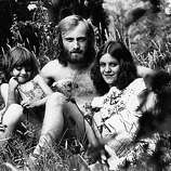 2nd August 1976: Phil Collins, drummer and singer who plays with progressive rock bands Genesis and Brand X, sits in the garden of his Epsom home with his wife Andy and 4-year-old daughter Joly.