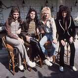 "September 1976: British rock group Queen at Les Ambassadeurs, where they were presented with silver, gold and platinum discs for sales in excess of 1 million of their hit single ""Bohemian Rhapsody."" The band are, from left to right, John Deacon, Freddie Mercury (Frederick Bulsara, 1946 - 1991), Roger Taylor and Brian May."
