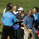 Spencer Levin (center) shakes hands as he finishes his third round at Spyglass Hill during the AT&T Pebble Beach National Pro-Am on Saturday. Levin finished the day at 8 under par for the tournament.