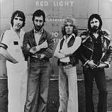 "British rock group The Who, comprising of, from left to right; Keith Moon (1947 - 1978), Pete Townshend, Roger Daltrey and John Entwistle (1944 - 2002). The group are currently working on a film, ""The Kids Are Alright,"" which looks back at fifteen years of The Who on the road, in recording studios and interviews."