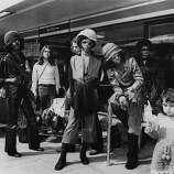 American soul funk group Sly and the Family Stone, with Sly Stone (Sylvester Stewart) sitting front, right.