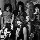 Influential American glam rock band the New York Dolls; David Johannson, front, Jerry Nolan, Johnny Thunders, Killer Kane and Sylvain Sylvain, pose in a dressing room.
