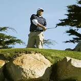 Steve Marino watches his tee shot to the par-3 11th hole in the third round of the AT&T Pebble Beach National Pro-Am on Saturday. Marino is at 12 under par.