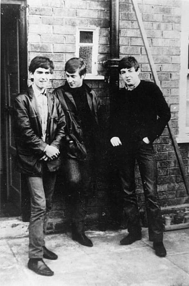 Circa 1960: Liverpudlian skiffle beat band The Beatles standing outside Paul's Liverpool home (left to right) George Harrison (1943 - 2001), John Lennon (1940 - 1980), Paul McCartney. Ringo Starr was not to join the band for another two years.. Photo: Keystone