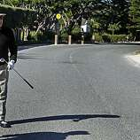 Actor Andy Garcia stands over his ball, asking officials for direction after he hit it over the third green in the third round of the AT&T Pebble Beach National Pro-Am on Saturday.