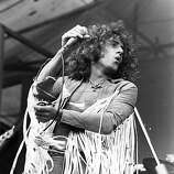 Singer Roger Daltrey performing with rock group the Who at the Isle of Wight Festival of Music, 1969..