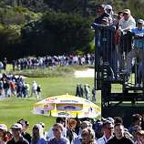 Thousands of spectators follow their favorite celebrities and golfers in the third round of the AT&T Pebble Beach National Pro-Am on Saturday.