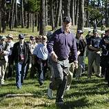 The gallery follows Actor-Comedian Bill Murray out of the woods after Murray hit his approach shot onto the 18th green at Spyglass Hill Golf Course during second round action of the AT&T Pebble Beach National Pro-Am Golf Tournament in Pebble Beach, CA. Friday Feb.11, 2011.