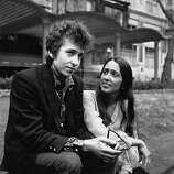 American electric folk hero Bob Dylan (born Robert Zimmerman) and singer, songwriter Joan Baez in Embankment Gardens, London..