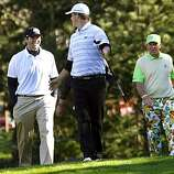 Tony Romo left and John Daly right joke with Giants pitcher Matt Cain after Cain killed his drive on the 14th green at Spyglass Hill Golf Course during second round action of the AT&T Pebble Beach National Pro-Am Golf Tournament in Pebble Beach, CA. Friday Feb.11, 2011.
