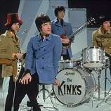 The Kinks, (L-R) Dave Davies, Ray Davies, Peter Quaife, and Mick Avory, wait on the set of a television show, ready to perform, 1968..