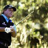Phil Mickelson tees off on the 12th hole at Spyglass Hill Golf Course during second round action of the AT&T Pebble Beach National Pro-Am Golf Tournament in Pebble Beach, CA. Friday Feb.11, 2011.
