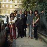 1969: English composer Sir Malcolm Arnold poses with newly formed British heavy metal rock band Deep Purple. From left to right are : Ian Paice (drums), Jon Lord (keyboards), Sir Malcolm Arnold, Ritchie Blackmore (guitar), Ian Gillan (vocals) and Roger Glover (bass guitar)..