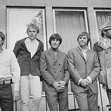 7th November 1966: American rock group The Beach Boys after a concert at the Finsbury Astoria. They are, (from left to right) Bruce Johnston, Al Jardine (front), Dennis Wilson (1944 - 1983), Carl Wilson (1946 - 1998), and Mike Love..