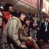 10th December 1968: Members of the Who and the Rolling Stones at Internel Studios in Stonebridge Park, Wembley, during the making of the Rolling Stones Rock and Roll Circus, (from left) Pete Townshend, Keith Moon (1947-1978) and Charlie Watts. The Rolling Stones bassist, Bill Wyman, is stood behind them.